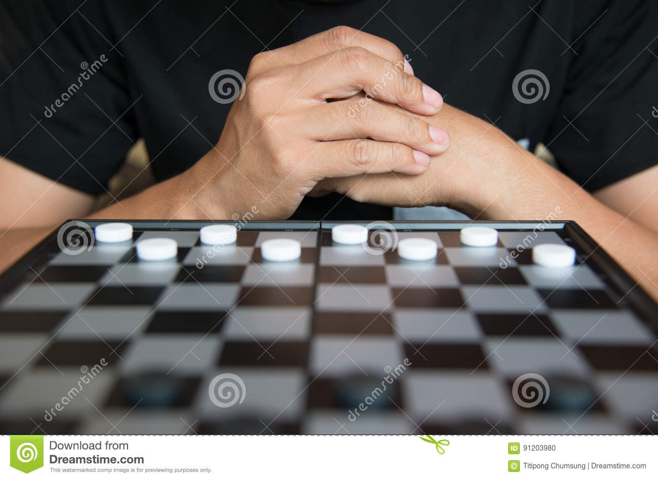 Young Businessman Concept Strategic Planning, Man playing checkers game