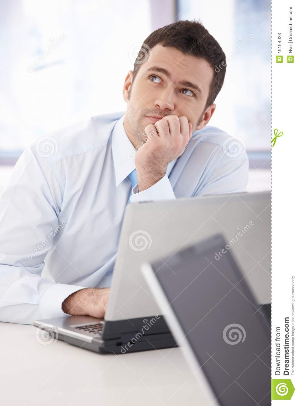 Young Businessman Daydreaming At Desk Stock Photos Image