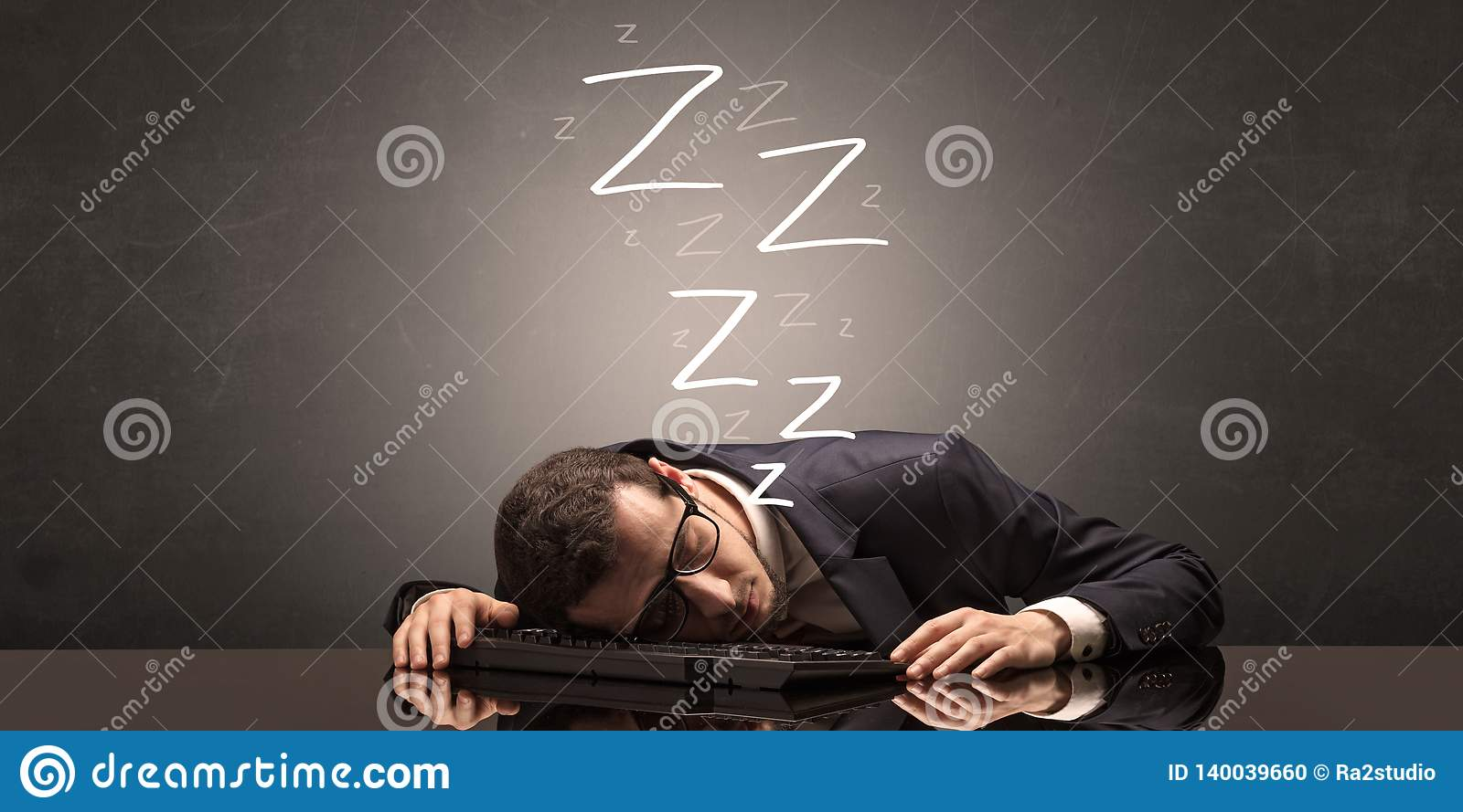 Businessman Fell Asleep At The Office On His Keyboard Stock