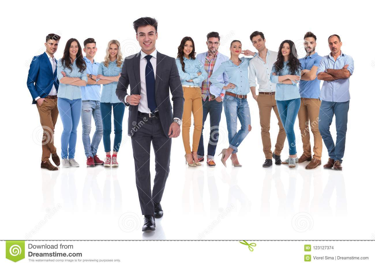 Young businessman group leader walks in front of the team