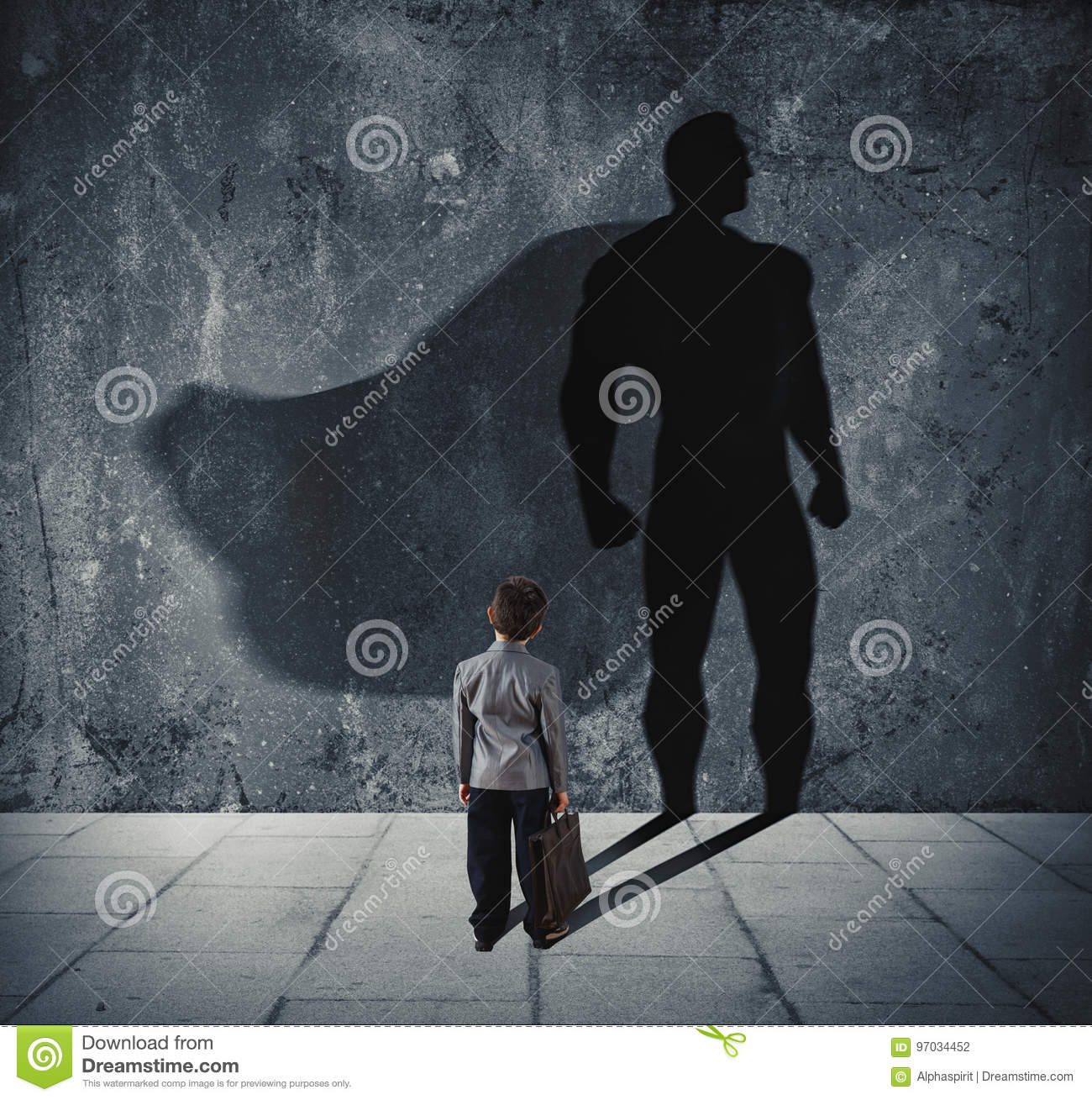 Young businessman with his shadow of super hero on the wall. Concept of powerful small man