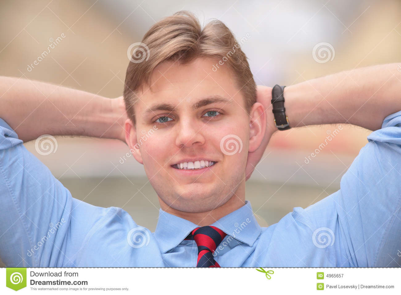 Technology Management Image: Young Businessman Holds Hands Behind Head Royalty Free