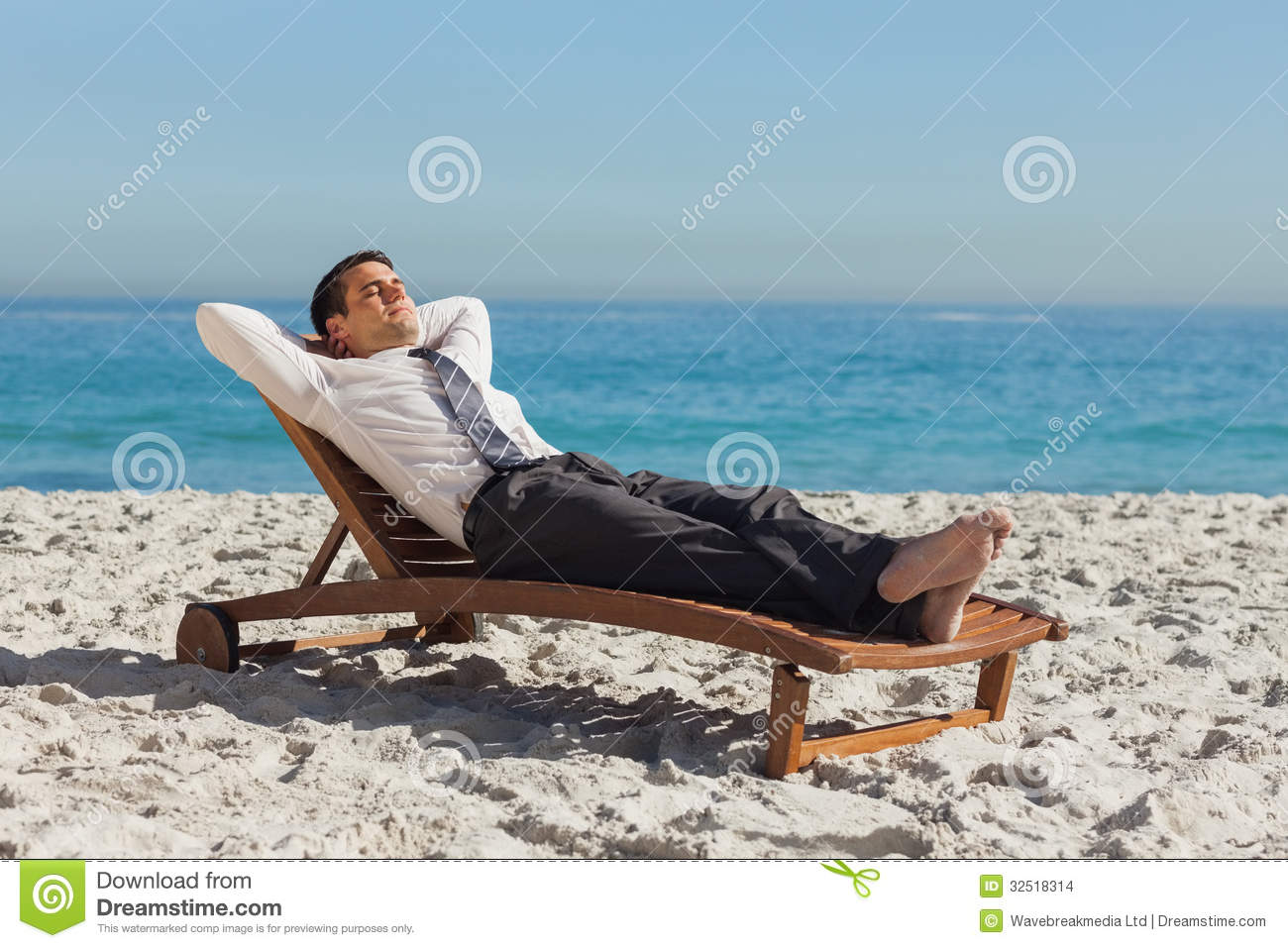 33a5cef004 Young Businessman Relaxing On A Deck Chair Stock Photo - Image of ...