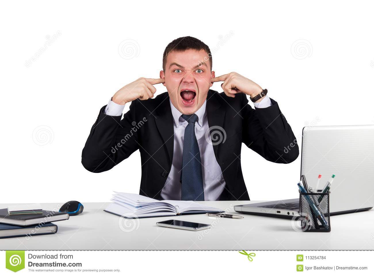 Young businessman shuts his ears with his hands and screaming isolated on white background