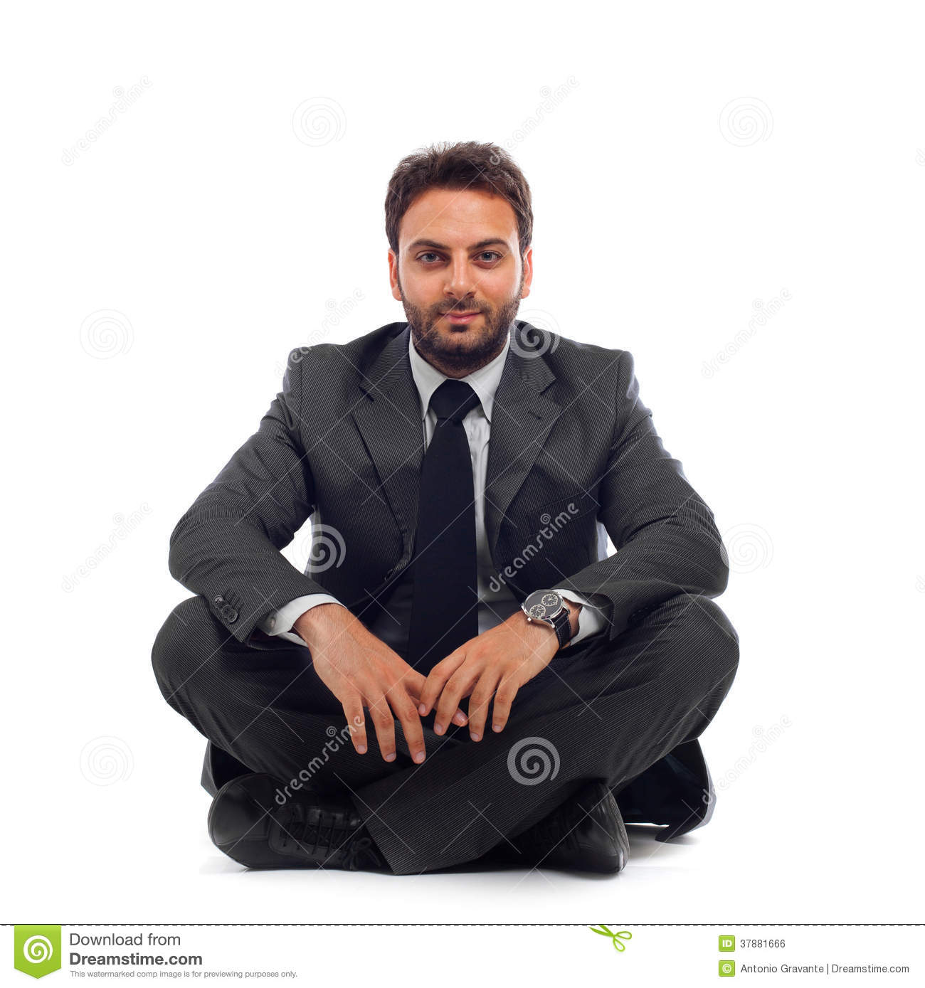 Young businessman sitting on the ground