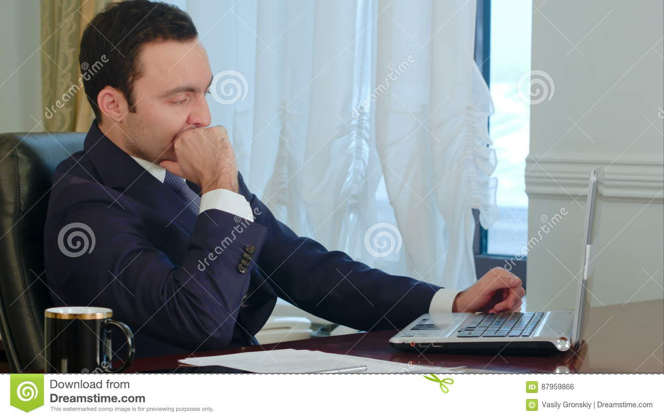 Young Businessman Stretching His Arms In Office And Start Working On