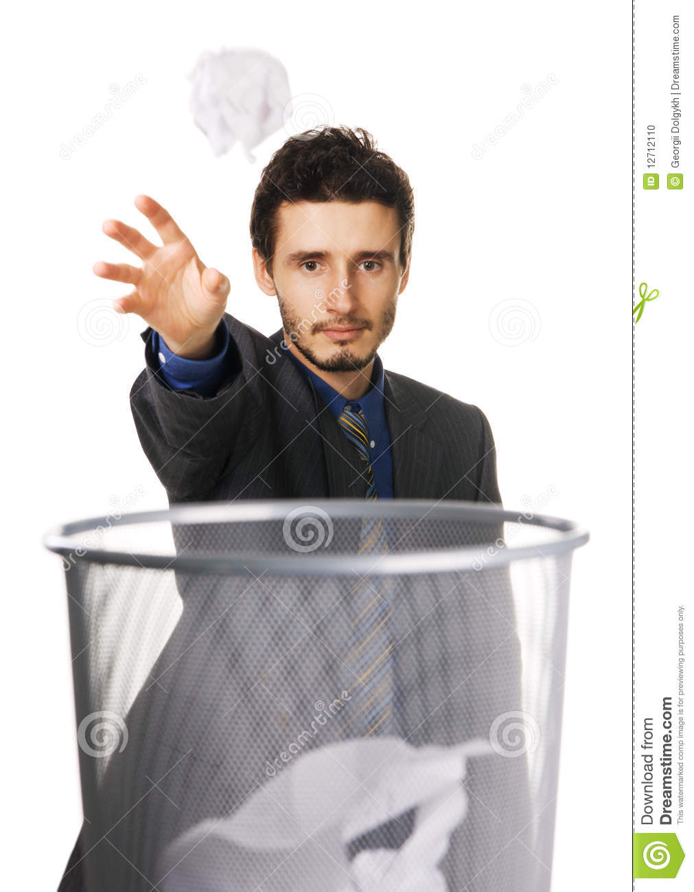 young businessman throwing paper at trash can stock photo