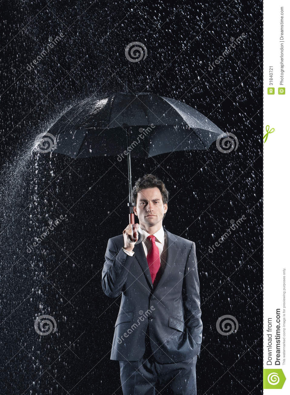 young businessman under umbrella in rain stock image