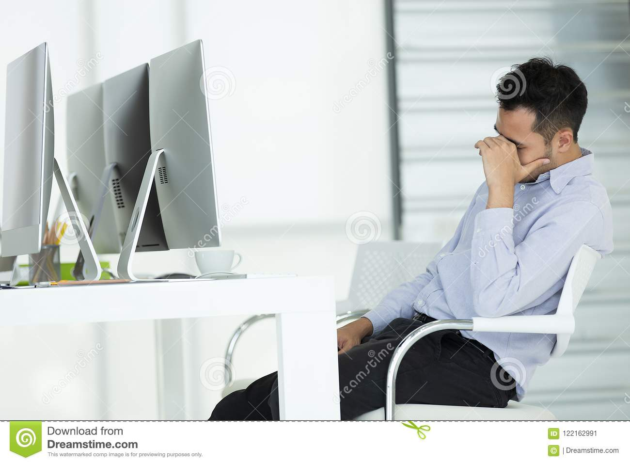 Young businessmen in stress. Sit in front of modern office computer, concept for hard work in an organization.