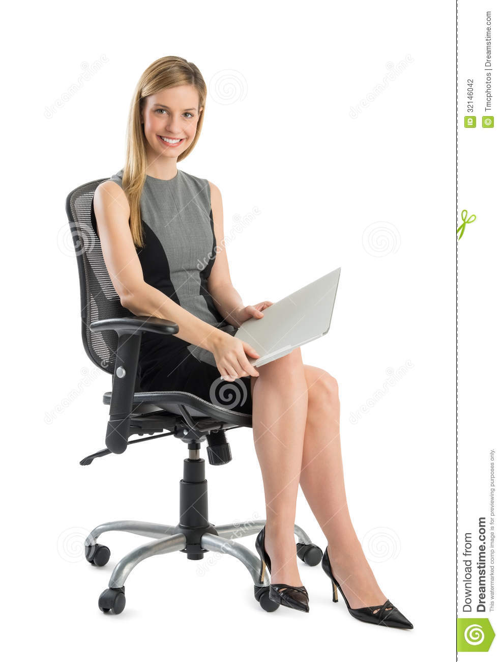 Businesswoman sitting on office chair with stock photo for Sitting chairs