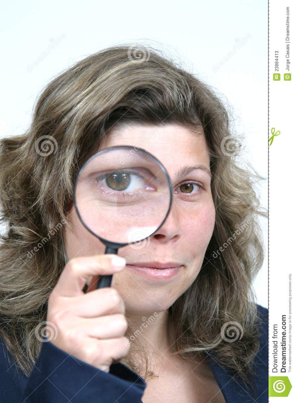 Young businesswoman holding Magnifying Glass