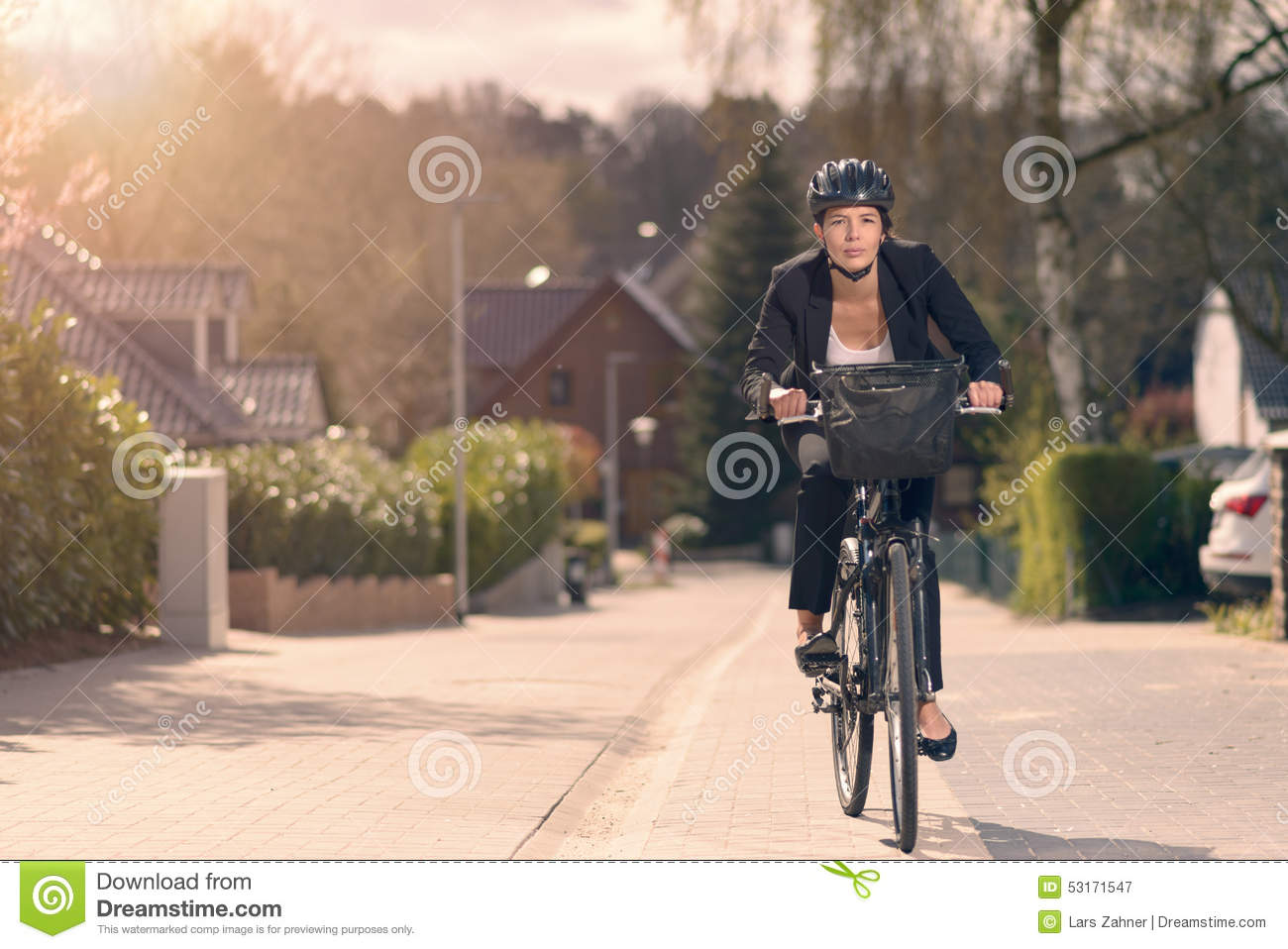 Young businesswoman riding to work on a bicycle