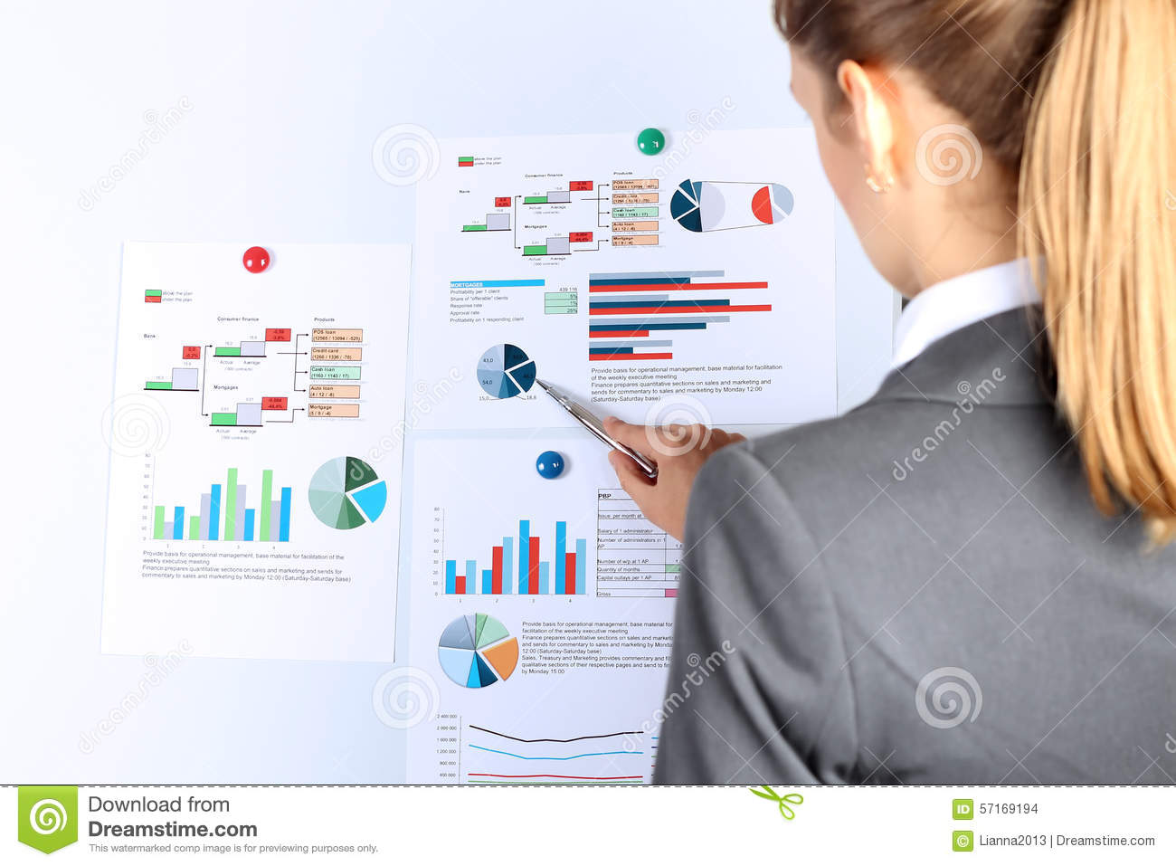 Young businesswoman showing graphs by pen. Presentatoin