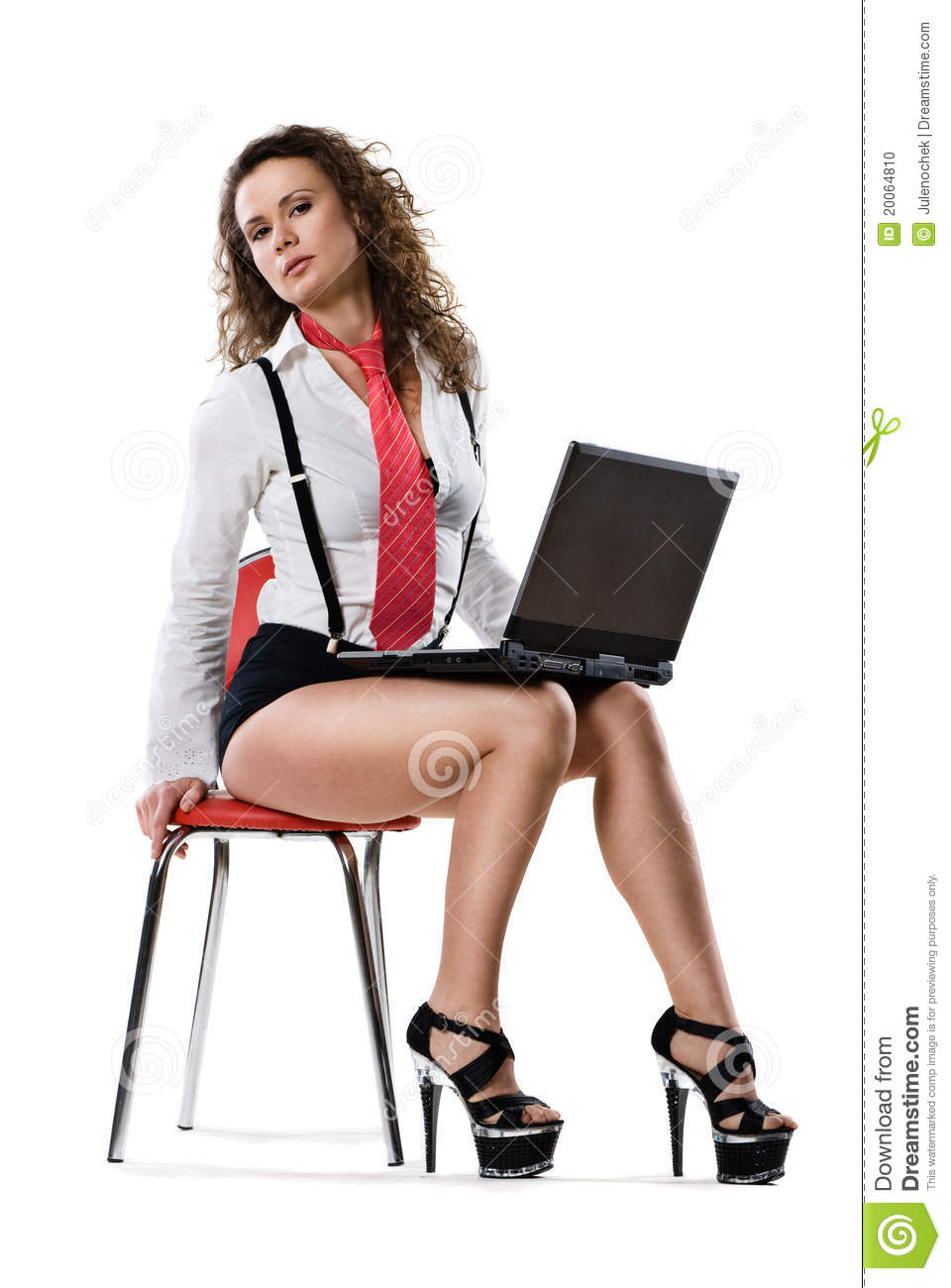 Young Businesswoman Sitting On Chair With Laptop Stock Photo - Image ...