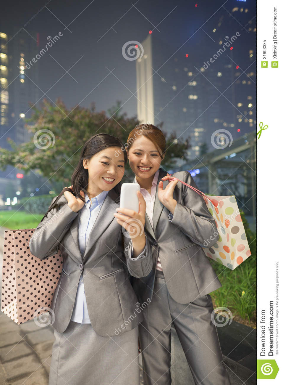 Young businesswomen taking self-portrait with Cell Phone.