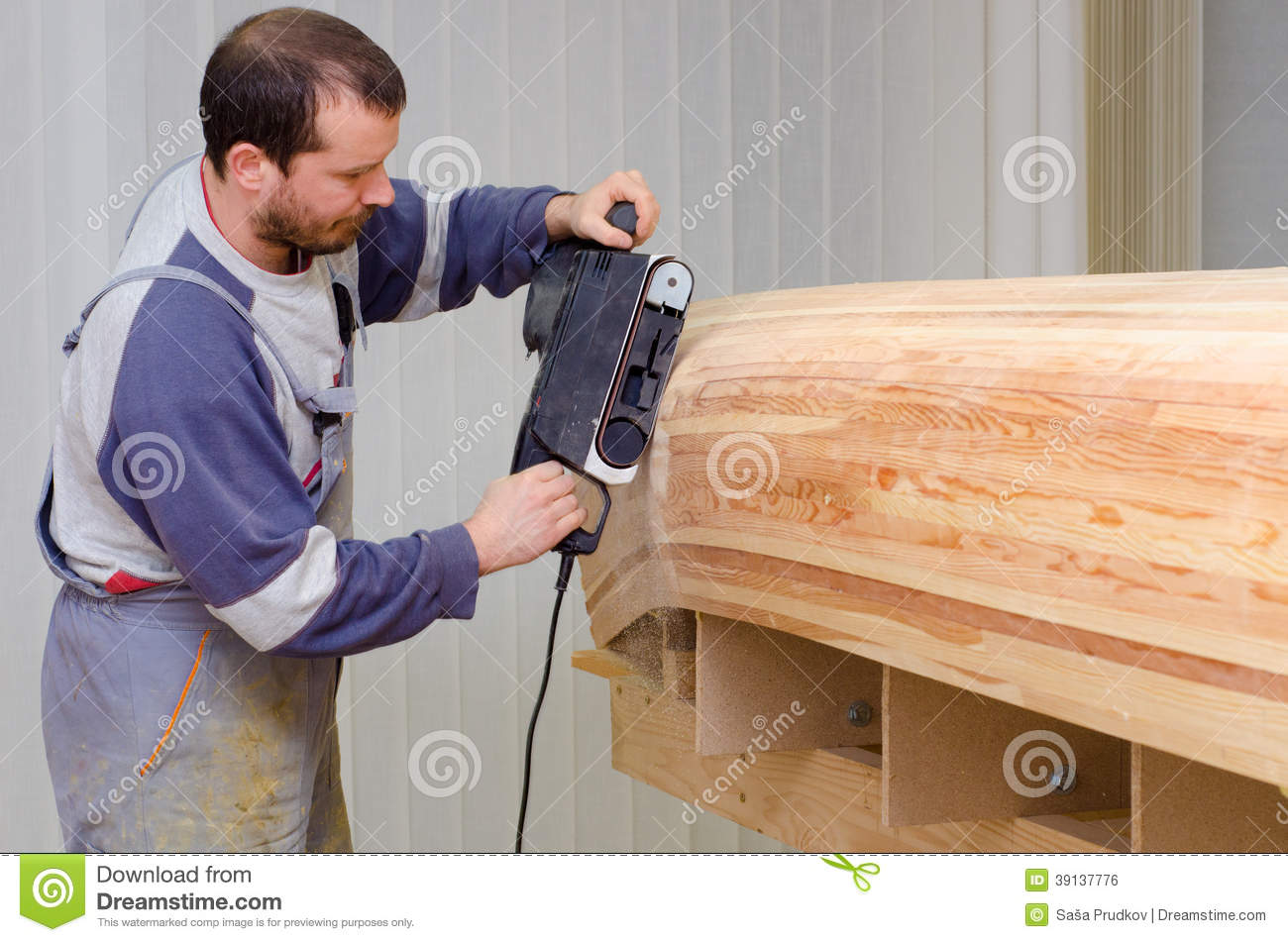 Young Carpenter Sanding New Canoe In Workshop Stock Photo Image Of