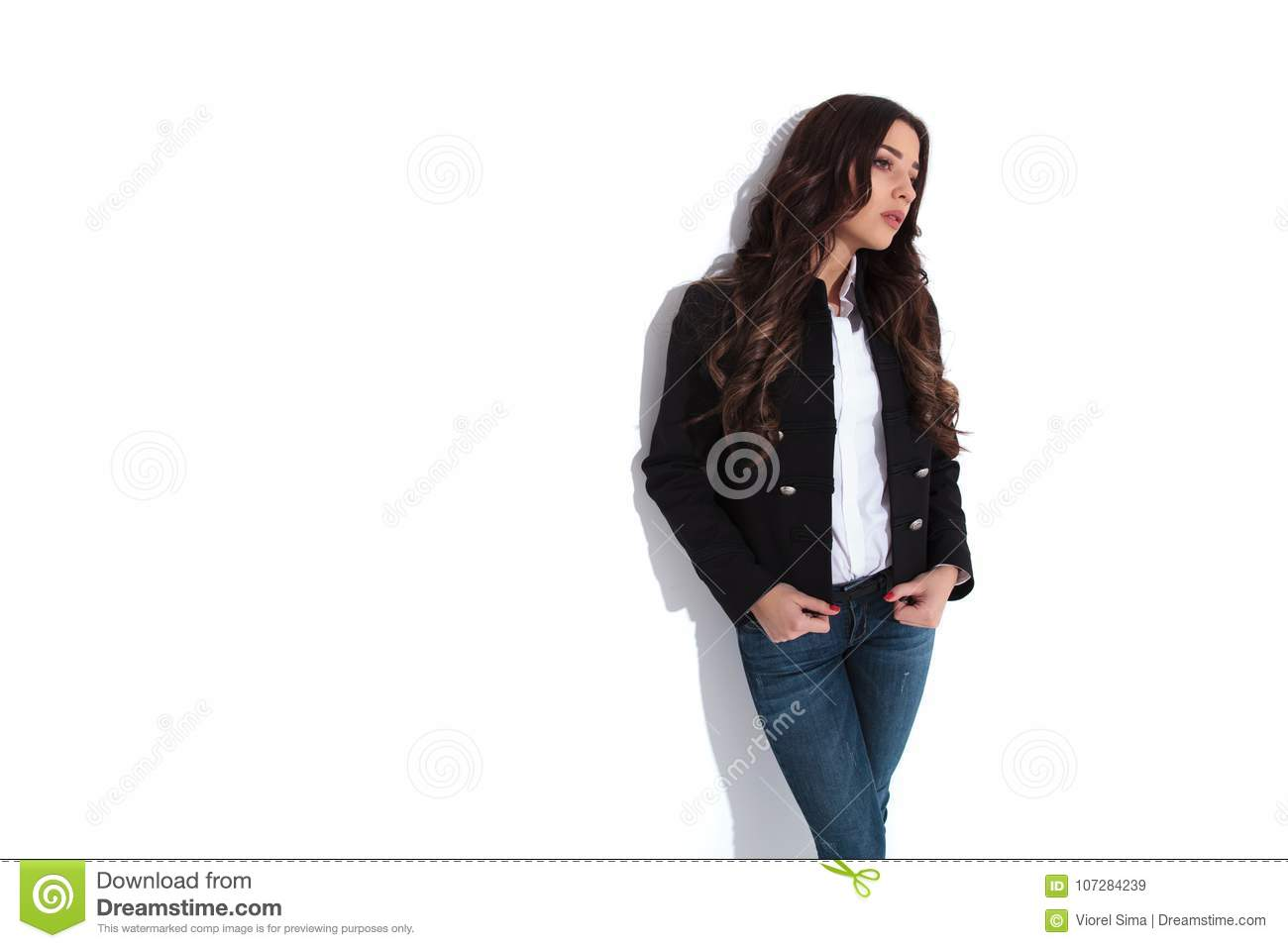 Young Casual Woman Posing And Looks Away To Side Stock Image
