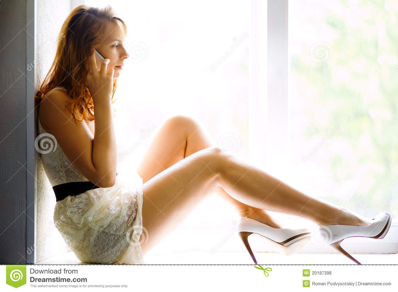 Young Casual Woman Sitting On Window And Smiling Royalty
