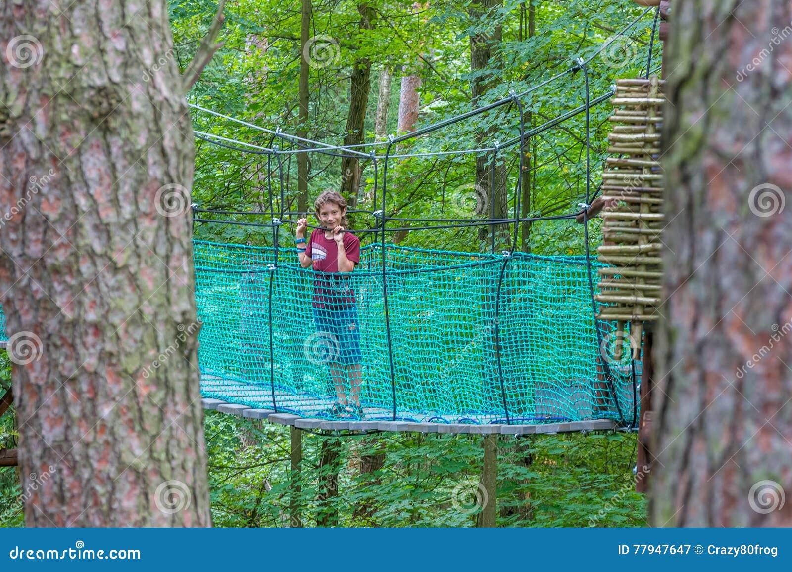 Young caucasian boy in adventure park