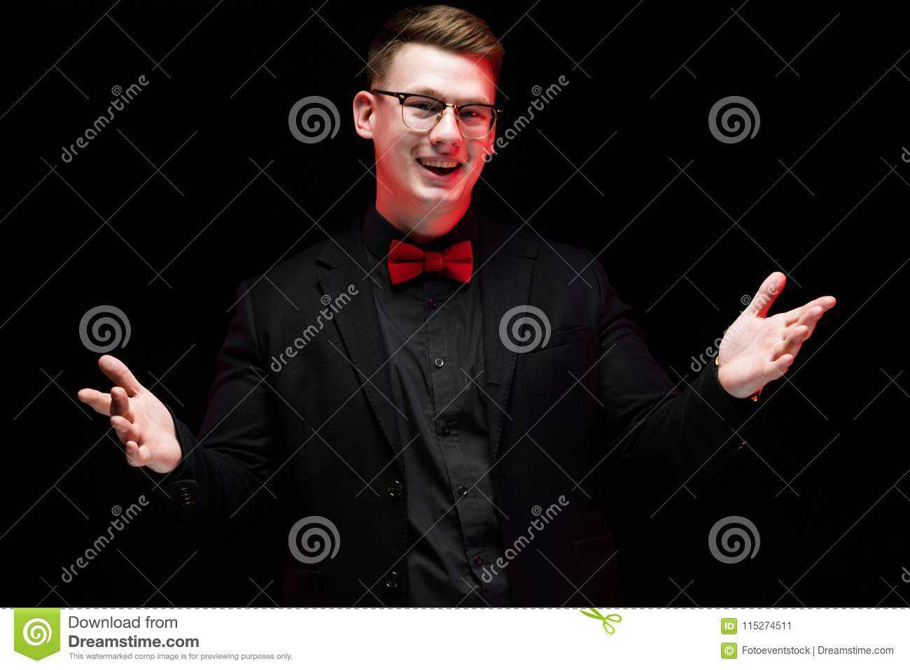 f77d090f2f23 Young caucasian elegant serious smart successful business man in black suit  with bow-tie standing in office looking in camera smiling happy