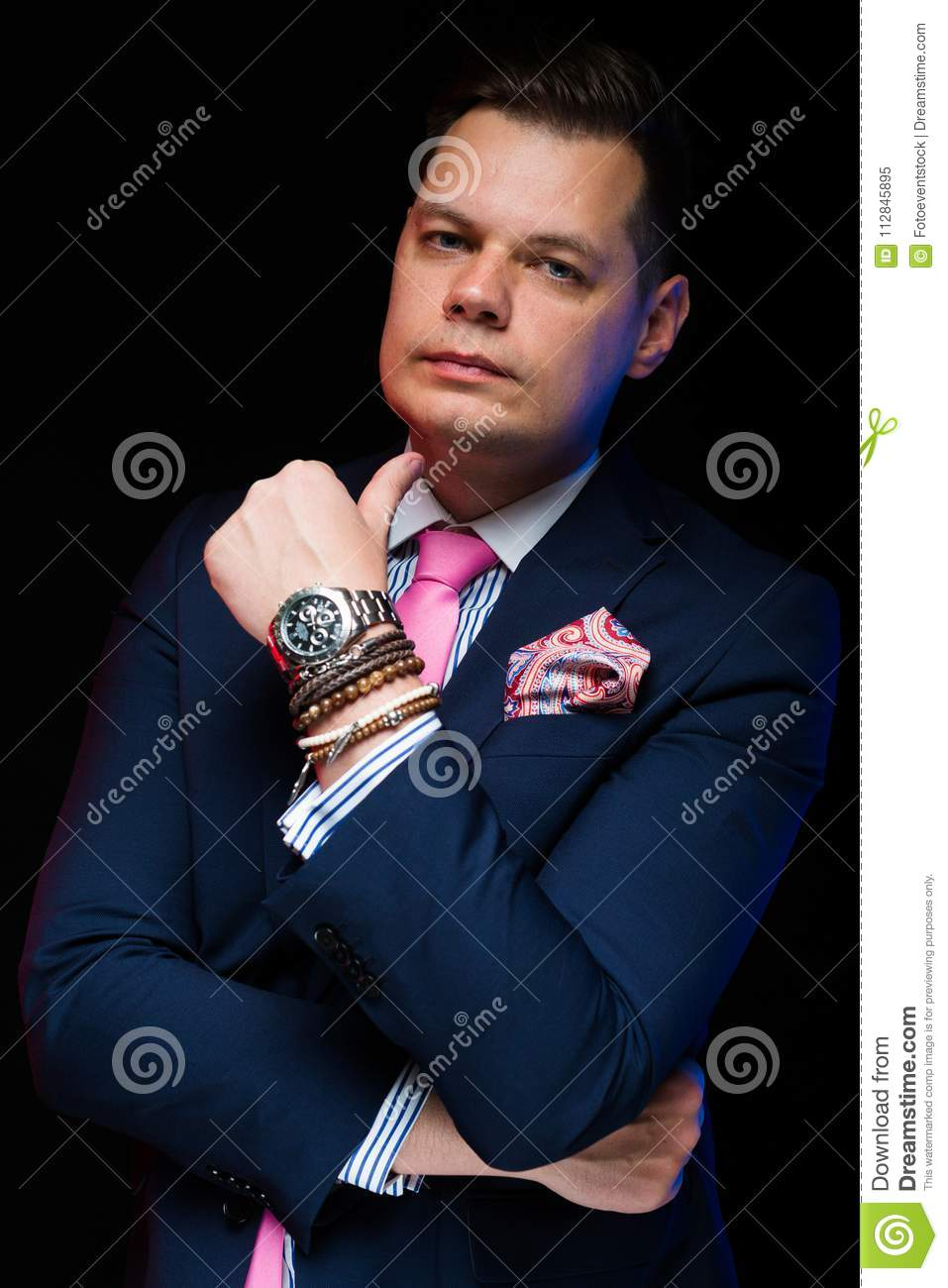 Portrait Of Confident Handsome Businessman With Crossed Arms