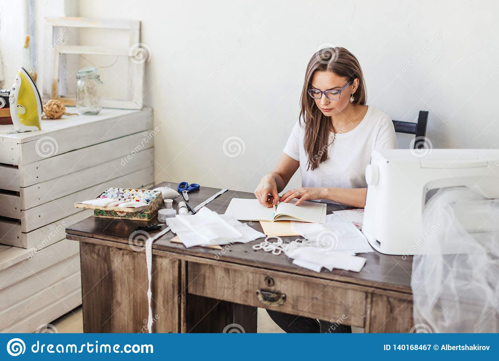 Fashion Designer At Work Talanted Dressmaker Drawing Sketch At Her Workspace Stock Image Image Of Caucasian Atelier 140168467