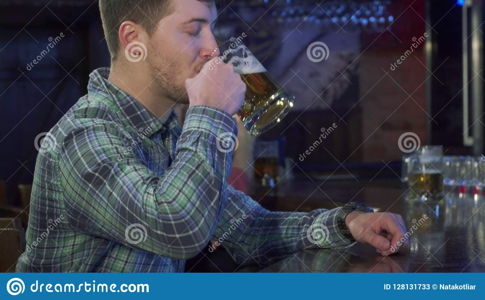 Man drinks beer at the pub