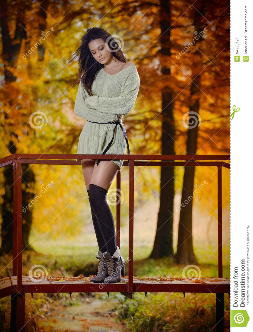 Young Caucasian sensual woman in a romantic autumn scenery. Fall lady .Fashion portrait of a beautiful young woman in forest