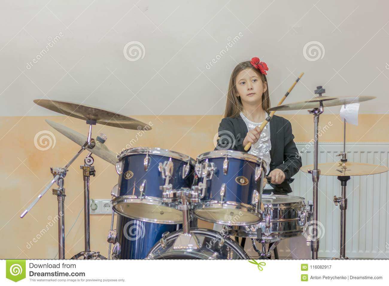 Young Caucasian Teenage Girl Plays The Drums Girl Playing The Drum Set Girl Learns