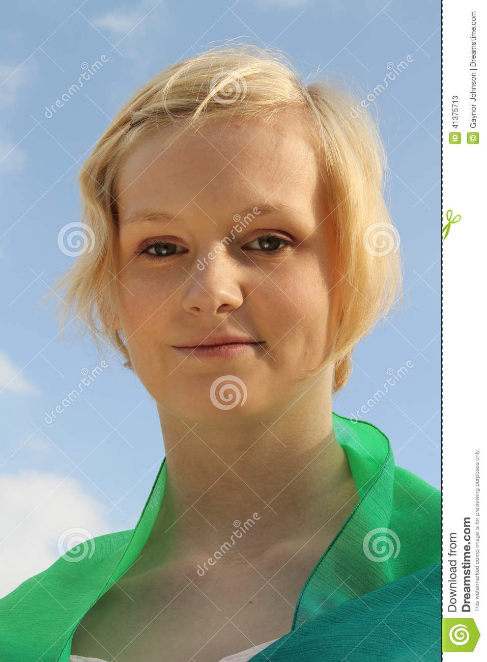 Young caucasian woman against bright blue sky