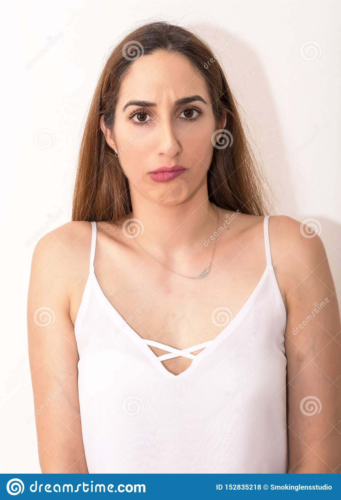 Young Caucasian woman with dissatisfaction and wonder