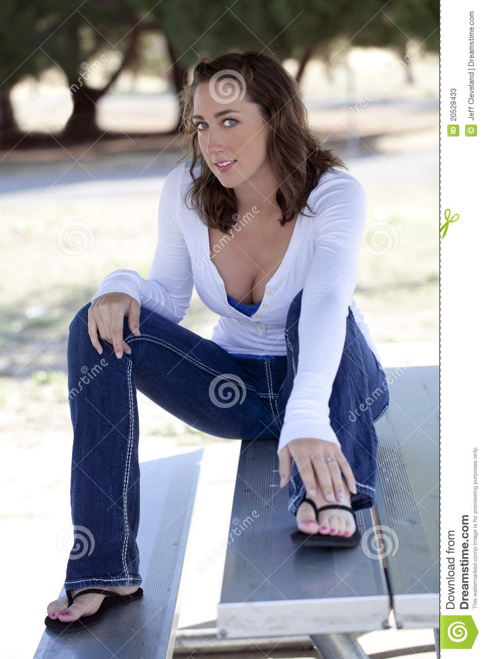 Young Caucasian Woman Sitting Outdoors Jeans Stock Photos ...