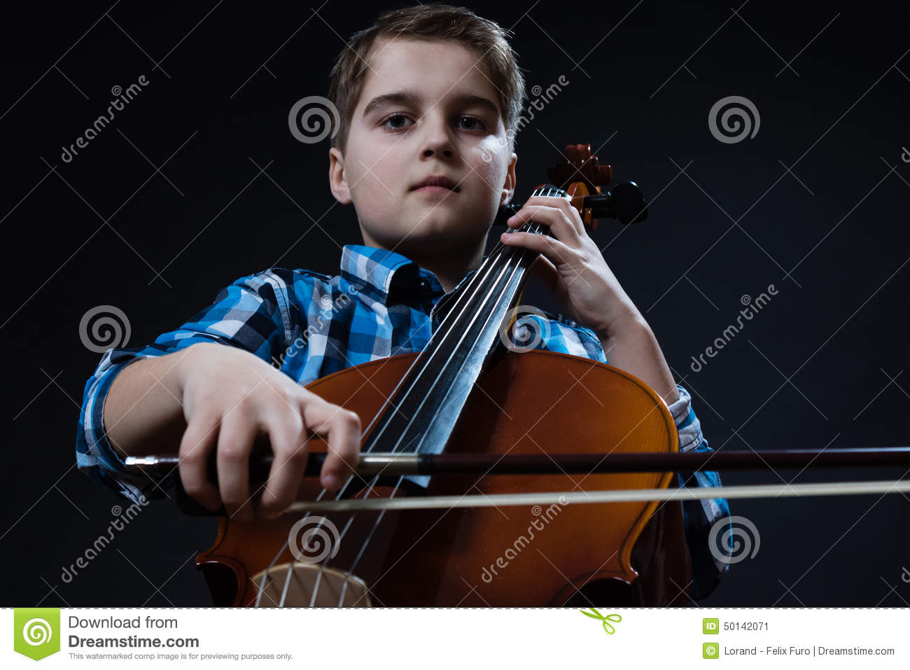 Young Cellist playing classical music on cello