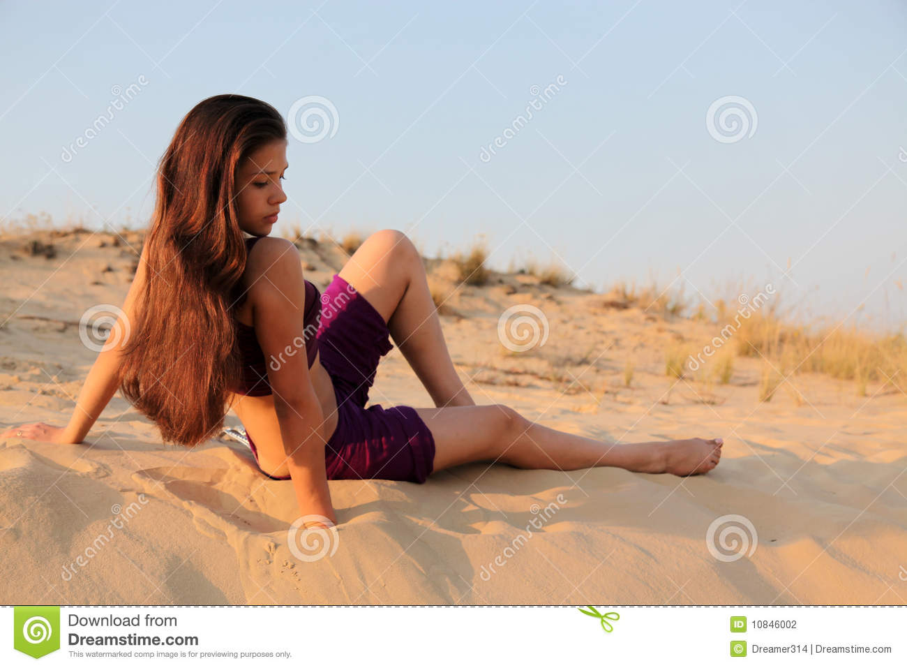 Young charming girl in desert