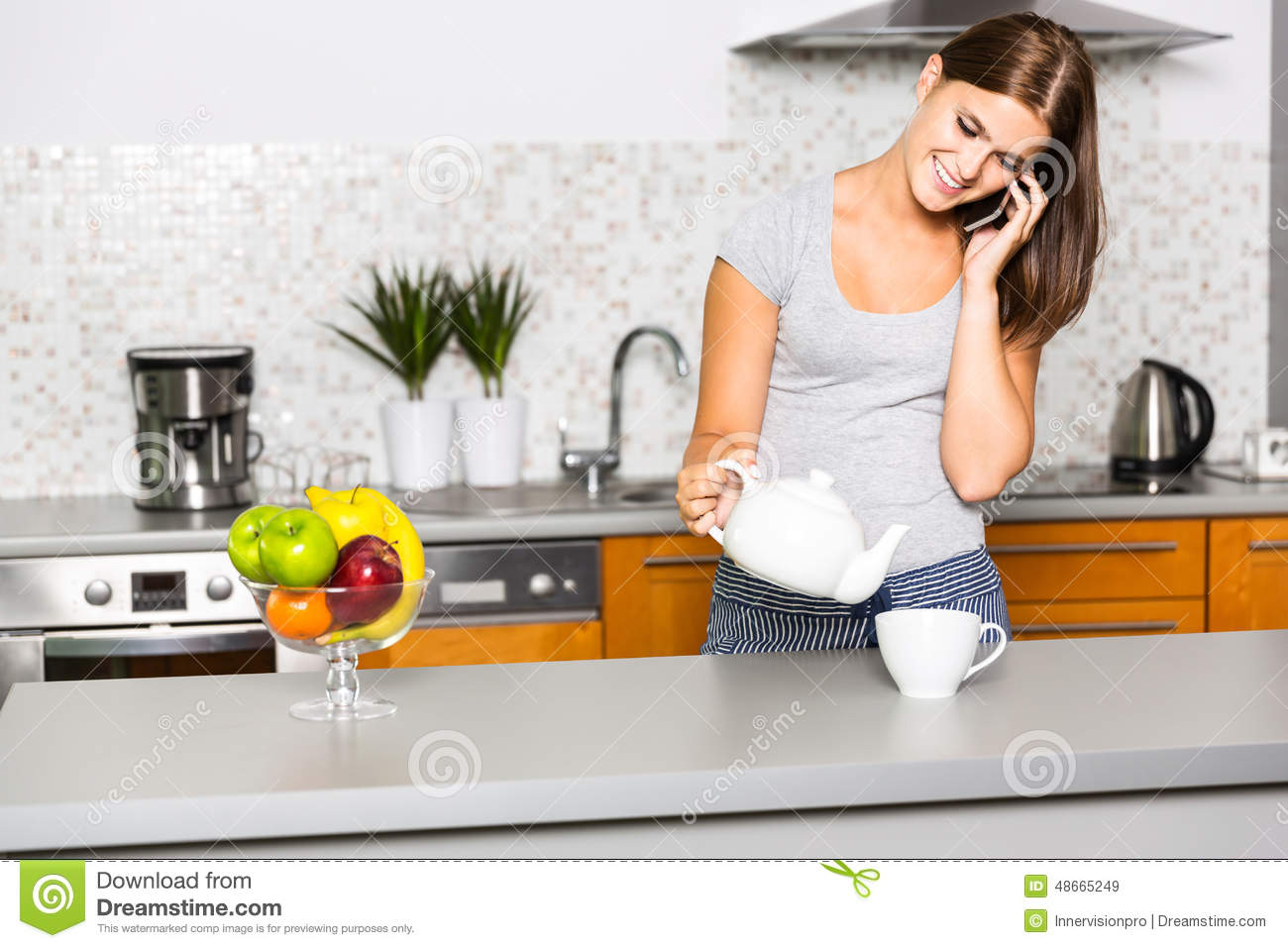 Young Cheerful Woman Talking On The Phone In Kitchen Stock Photo ...