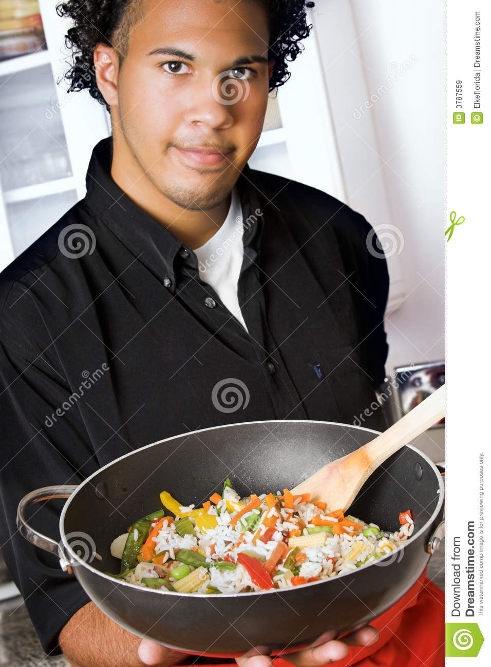 Young chef with wok