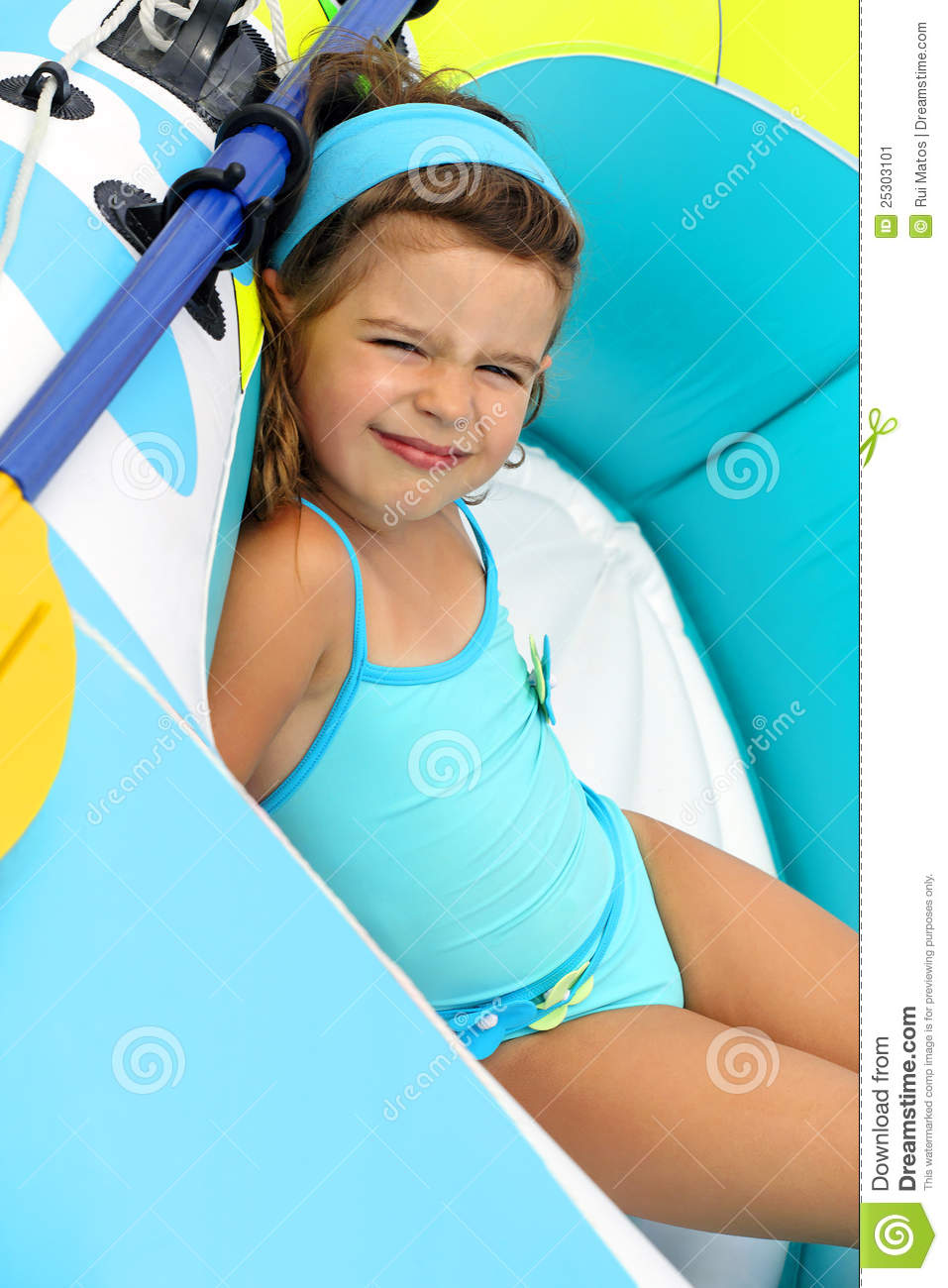 child in swimsuite young child in a boat