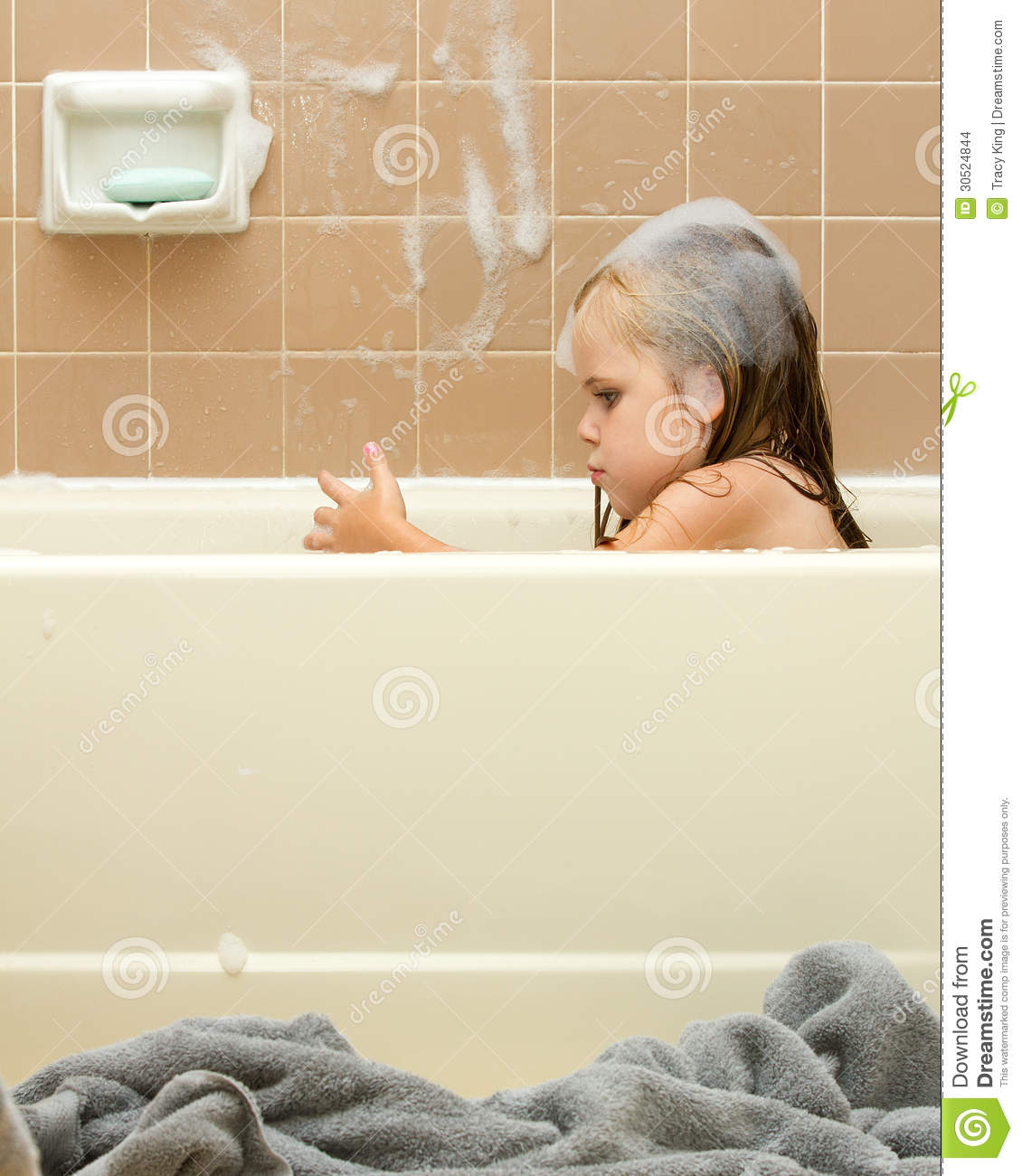 Young Child Cleaning In The Tub Stock Photo - Image of water, smile ...