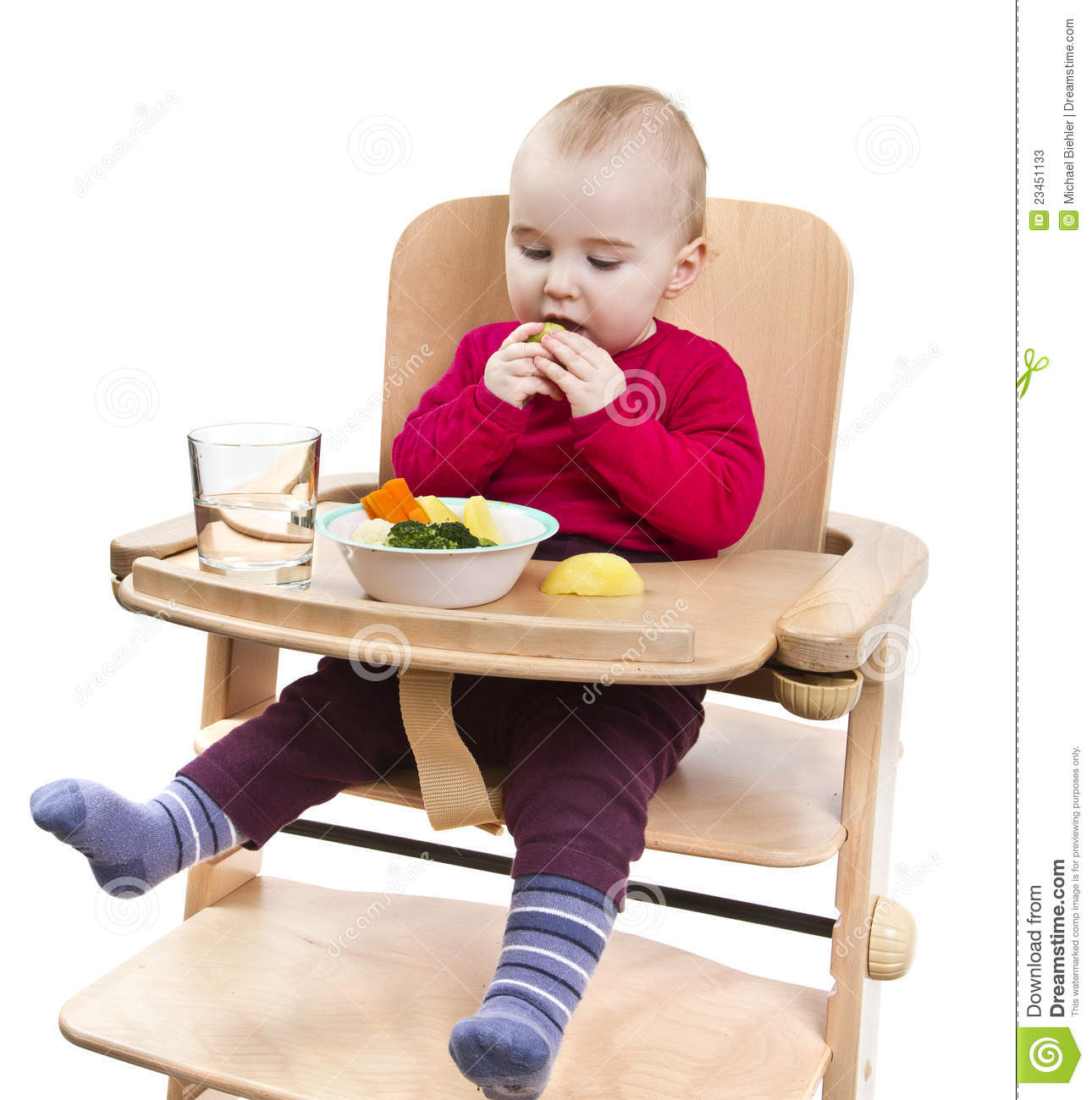 Young Child Eating In High Chair Stock Image Image Of