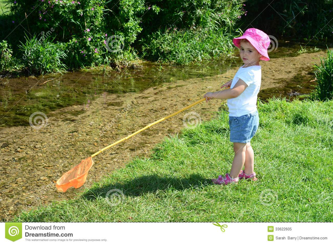 Young child fishing in a river royalty free stock photo for How many fishing rods per person in texas