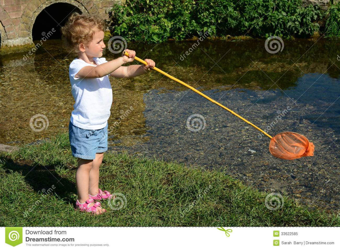Young child fishing in a river royalty free stock photo for Toddler fishing rod