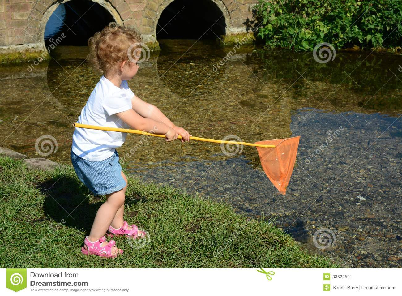 Young child fishing in a river stock image image 33622591 for Toddler fishing rod