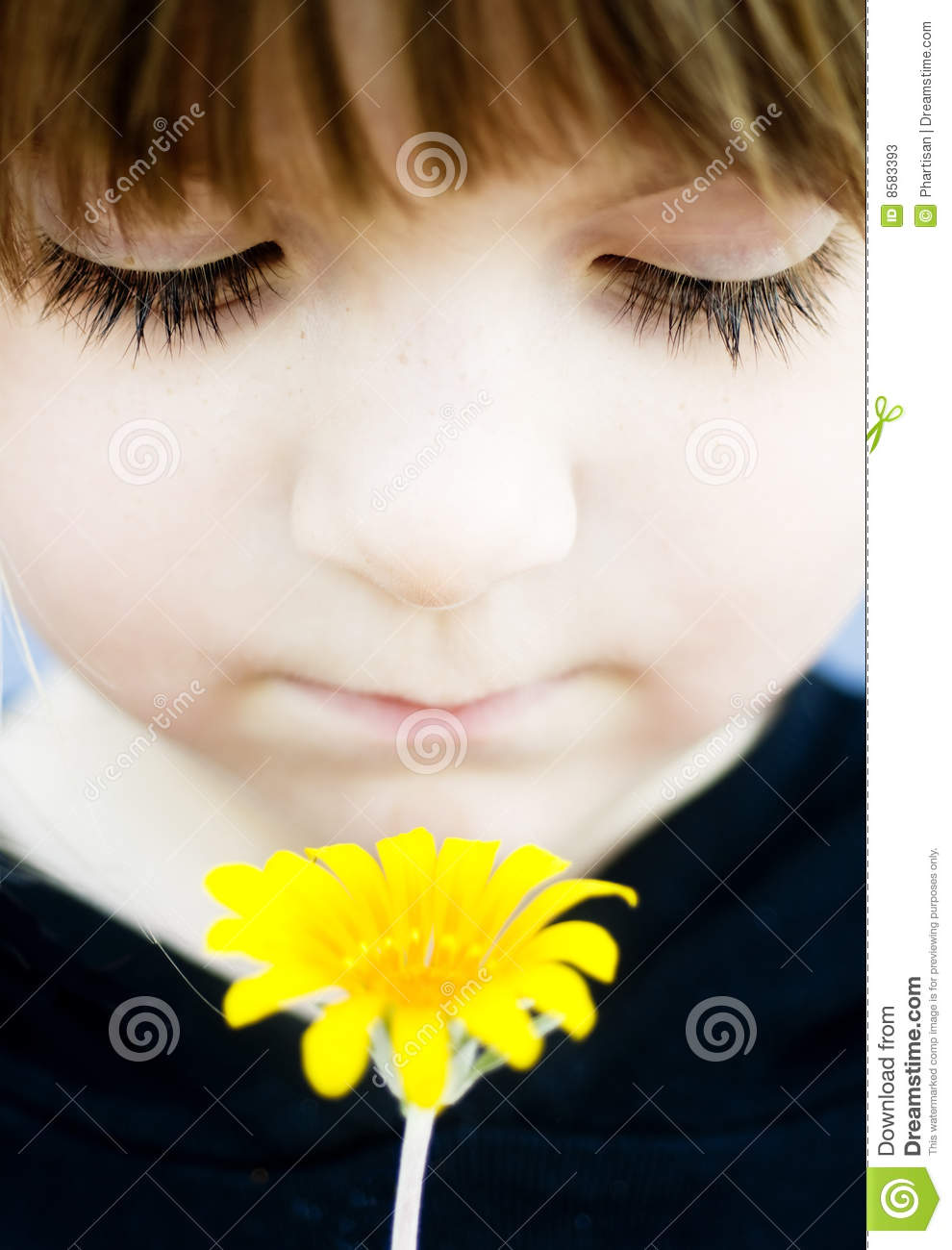 Young child holding flower