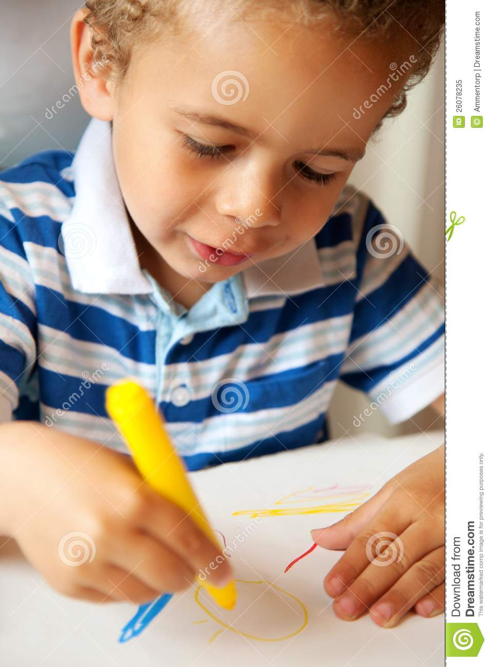 Young Child Holding A Yellow Crayon Royalty Free Stock