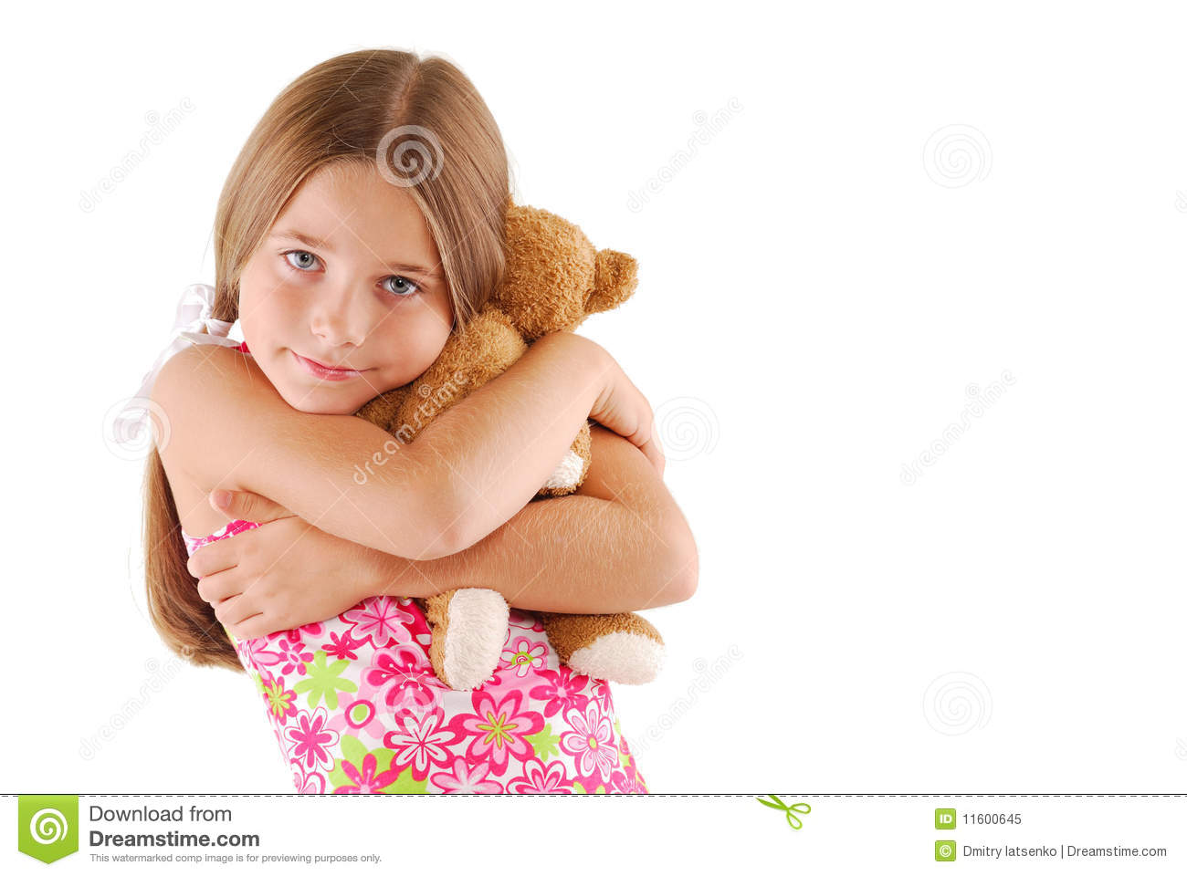 Young Child Hugging A Teddy Bear