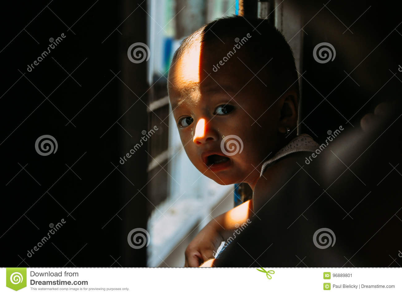 Young child riding the circle train in Yangon.