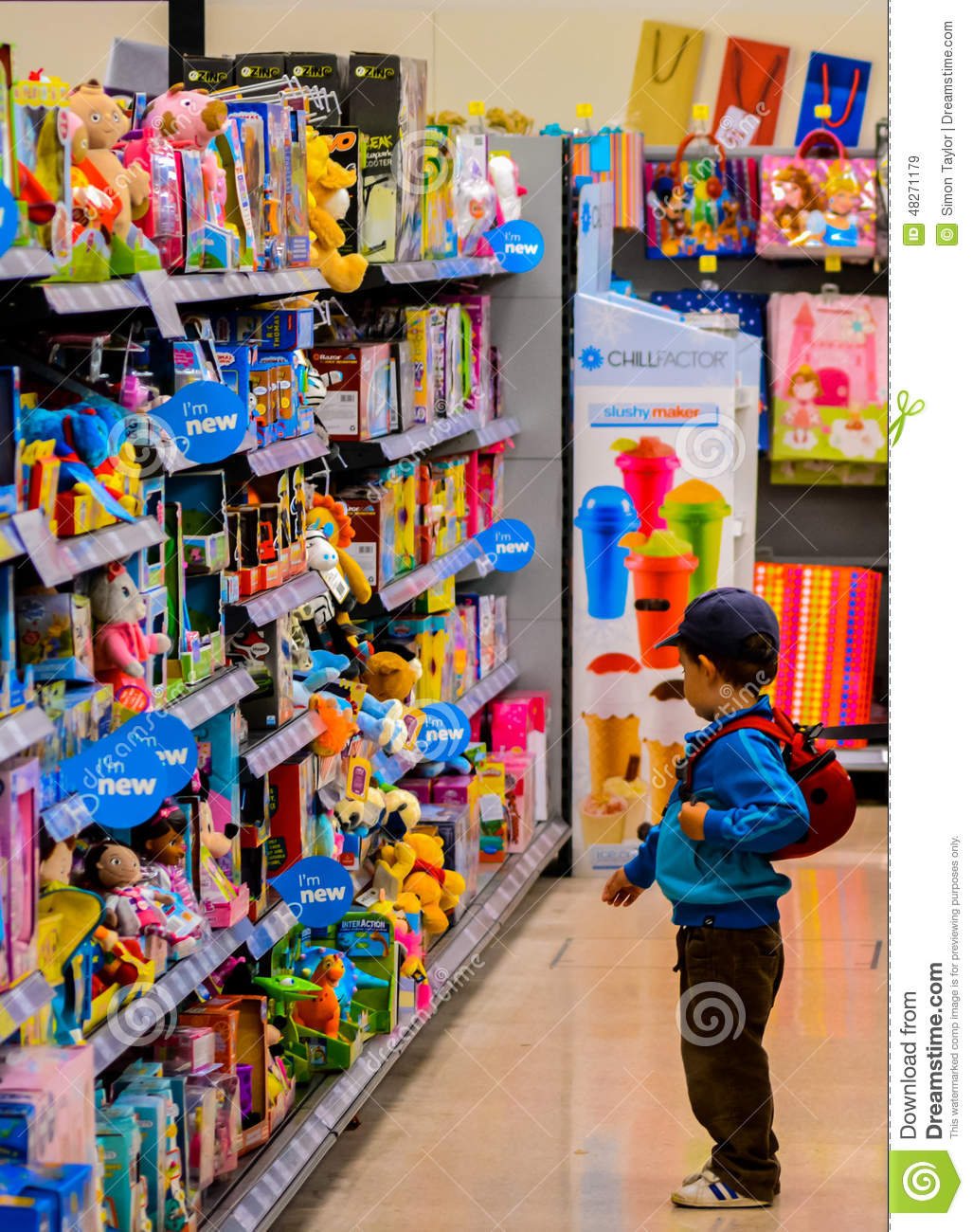 Toys For Young : A young child shopping toys editorial stock image