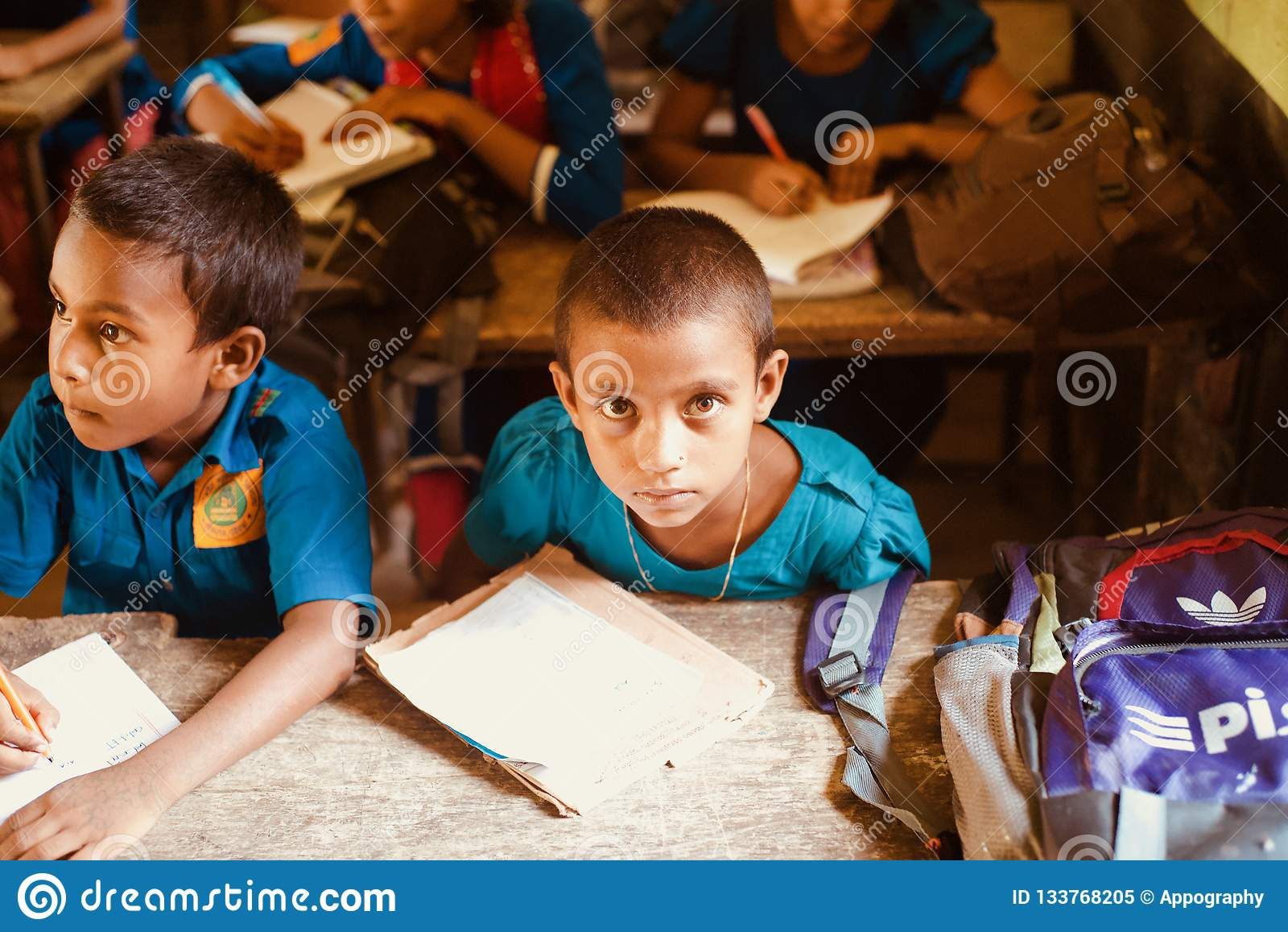 Young children studying in a classroom unique photo