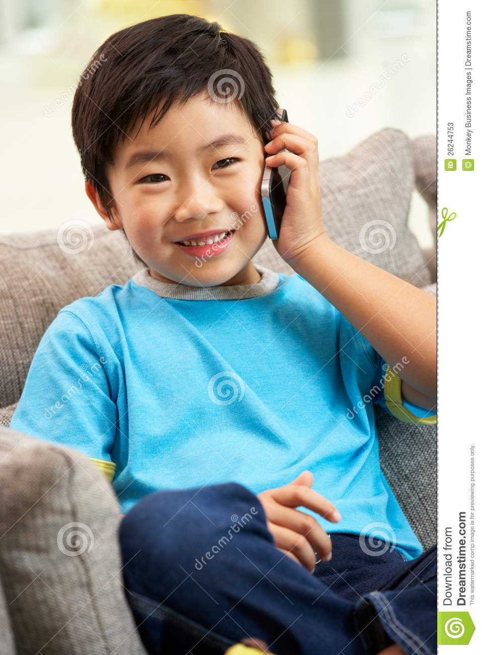 Young Chinese Boy Using Mobile Phone