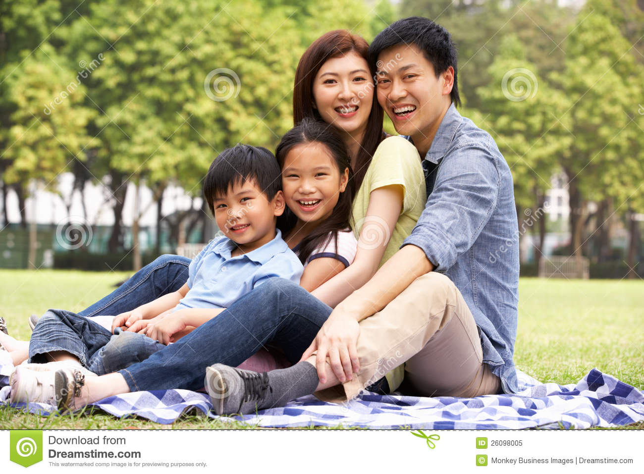 Young Chinese Family Relaxing In Park Together Royalty ...: http://www.dreamstime.com/royalty-free-stock-photo-young-chinese-family-relaxing-park-together-image26098005